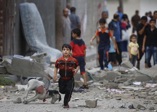 أطفال غزة وسوريا ضحايا الحصار والإنقسام والكاز العربي