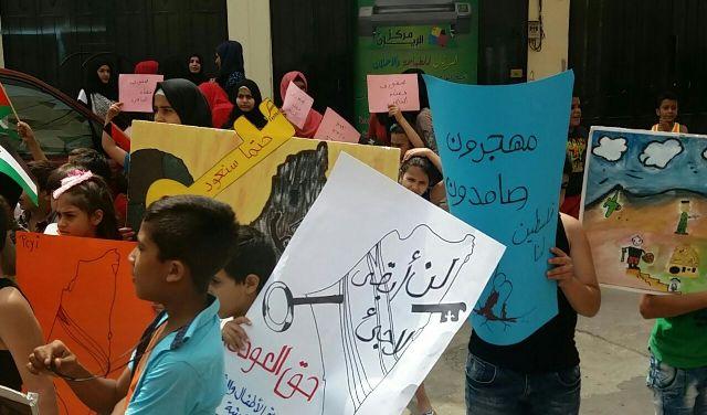 مسيرة لأطفال التدعيم النفسي في ذكرى النكبتين بمخيم نهر البارد.