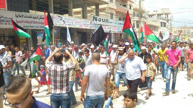 مسيره شعبيه احتجاجاً على تقليصات الأنروا في مخيم نهر البارد