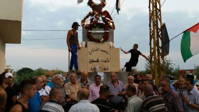 الشعبيه تشارك بوضع إكليل على النصب التذكاري للشهداء في مخيم نهر البارد