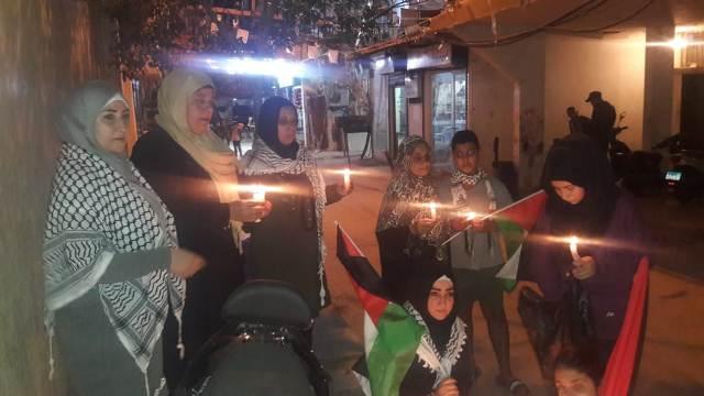 لجان المرأة الشعبية الفلسطينية تقيم وقفة تضامنية في مخيم برج البراجنة نصرة لغزة