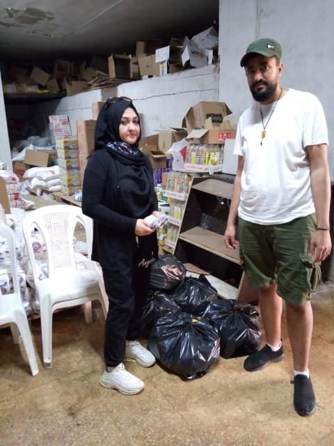 لجان المرأة الشعبية الفلسطينية توزع مبلغًا ماليًا وثيابًا للاطفال
