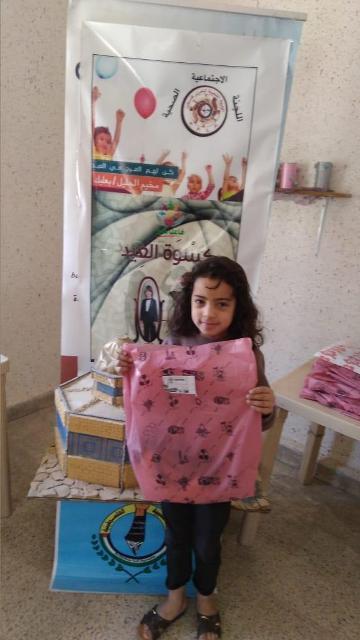 المنظمات الجماهيرية للجبهة الشعبية لتحرير فلسطين توزع ملابس العيد على الأطفال في مخيم الجليل