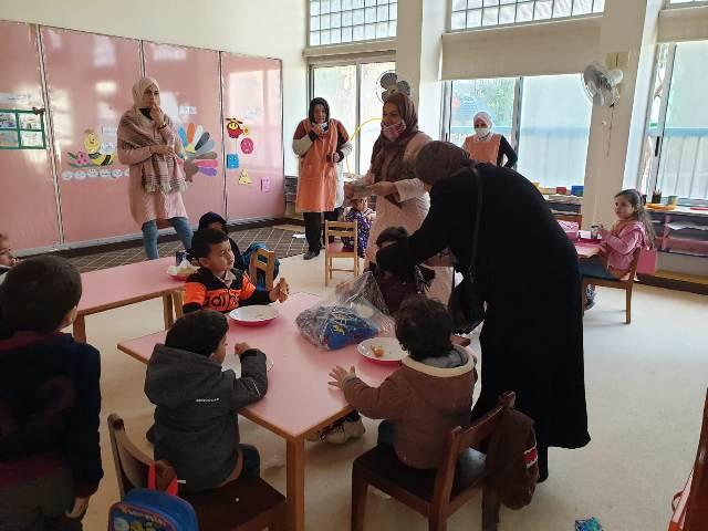 لجان المرأة الشعبية الفلسطينية توزع كمامات على أطفال مؤسسة غسان كنفاني في روضة مخيم نهر البارد