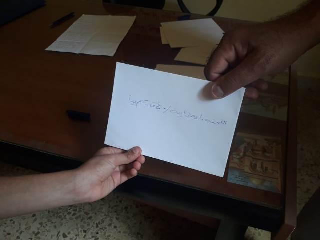 اللجنة الاجتماعية في صيدا توزع مساعدات نقدية في مخيم عين الحلوة