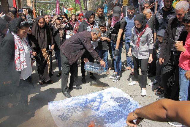 في جمعة إحراق العلم الصهيوني، لتعزيز صمود الشعب الفلسطيني في أرضه وفي الشتات