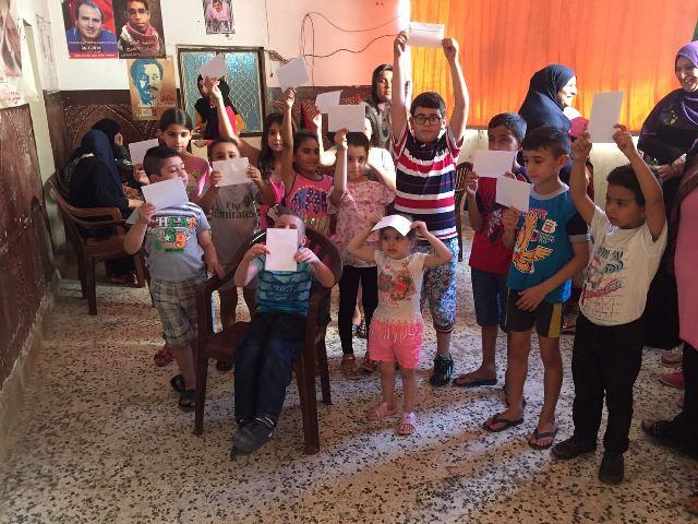 كسوة العيد ترسم ابتسامة على أفواه عدد من أطفال مخيمات صور