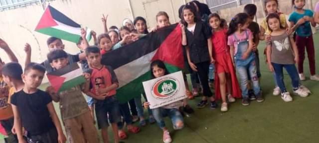 أطفال جمعية نواة يتضامنون مع أطفال فلسطين والقدس وغزة